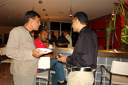 9/11 Event in Suriname — Me (on the right) having a discussion with two guests.