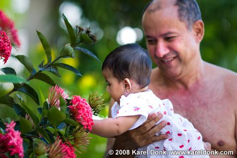 Canon EF 135mm f/2.0 lens sample — Sarah grabbing flowers. (135mm, f/2, 1/320s, ISO 100)