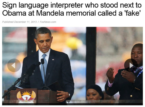 Fake interpreter standing behind scumbag Barack Obama
