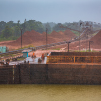 Industrial Photography for JP Knight — The crew busy in the rain connecting the two barges