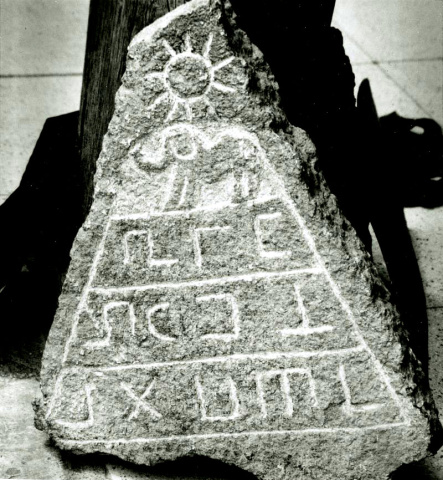 A stone artifact containing a pyramid with the sun.