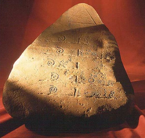 "Stone artifact with a pyramid containing the ""All Seeing Eye"""