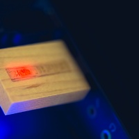 Custom USB Flash Drive — A red light inside the drive turns on when connected to the computer.